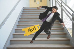 Man slipping on stairs