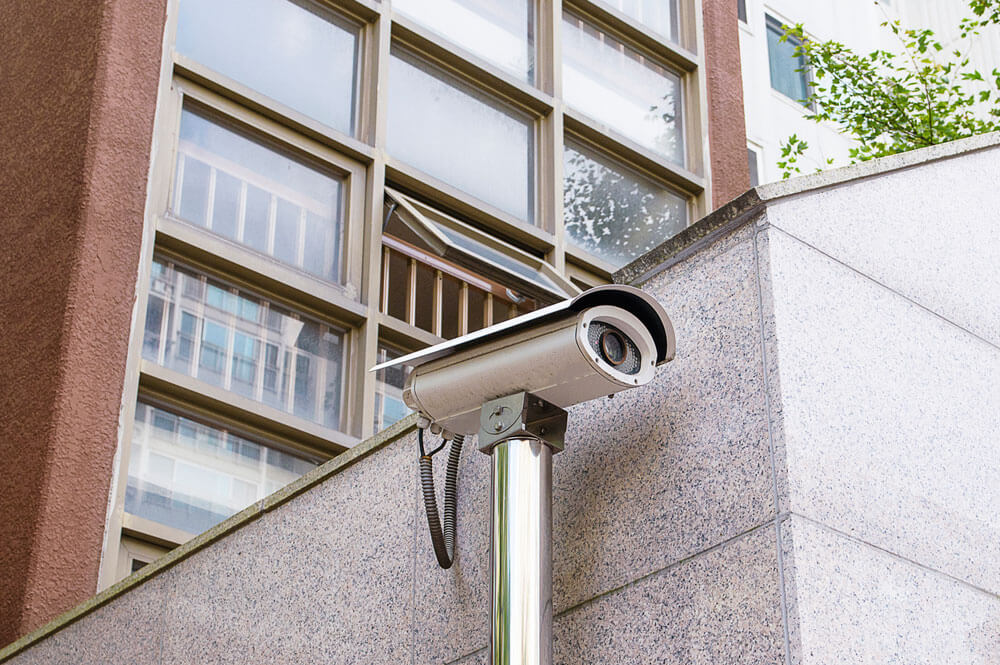 Security camera on apartment building entrance