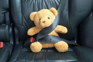Teddy bear in seat belt