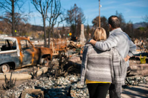 Couple Looks On After Home Fire