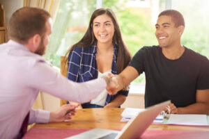 Man Shaking Hand With Real Estate Agent