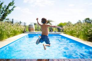 Kid jumping in pool