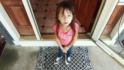 Child standing on doormat