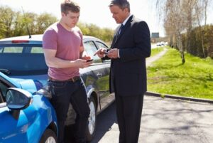 Insurance agent and customer discuss car policy