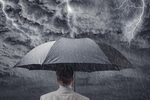 Man holding umbrella in rainstorm