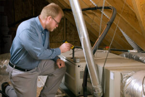 Man inspecting furnace