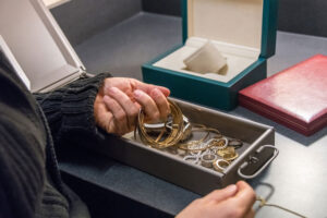 Hands in a jewelry box