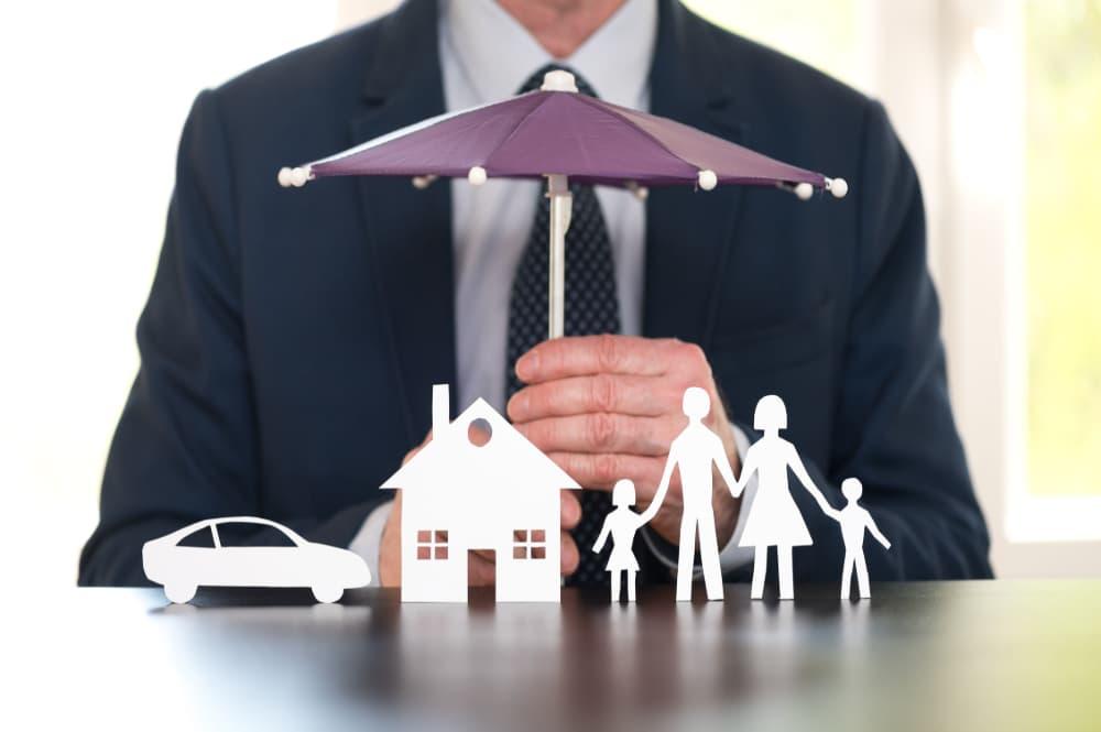 Insurance Agent Holding Umbrella
