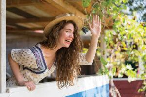 Woman waving hand from balcony