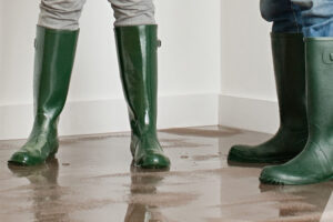 People wearing boots in a flooded room
